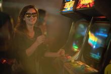 Girl Playing Arcade