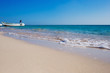 Beautiful seaside horizont with sand and blue water waves