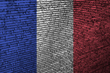 France Flag  Is Depicted On The Screen With The Program Code. The Concept Of Modern Technology And Site Development
