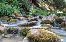Water Falling Over Rocks In An...