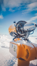 Image Of An Orange Snow Cannon In The Alps