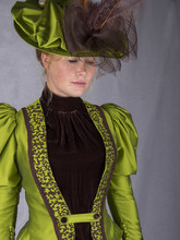 Victorian Woman In Green Ensemble With Hat