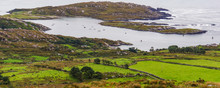 View Of Green Fields, Rocky Shore And Bay  While Driving Along The Ring Of Kerry