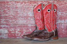 Red Cowboy Boots On Red Barn B...