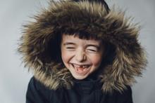 Close-up Of Happy Boy In Fur C...