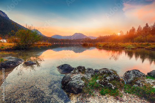 Fotobehang Grijze traf. Fantastic autumn sunset of Hintersee lake