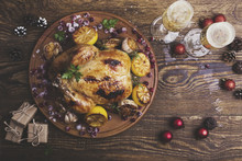 Overhead View Of Chicken With Wine And Christmas Decorations On Wooden Table