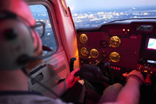 Male Pilot Flying Airplane Dur...