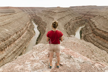 Full Length Of Female Hiker Standing On Rock At Horseshoe Bend