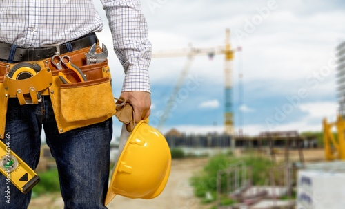 Fototapety, obrazy: Worker with a tool belt. Isolated over