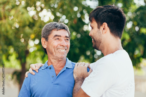 Tableau sur Toile portrait of happy father and son walking outdoors.