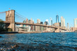 View of Brooklyn Bridge and Manhattan skyline at the early morning sun light - New York City downtown