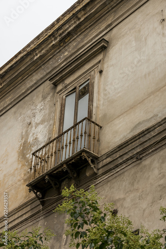 Fotobehang Napels Window with balcony in shabby streets of Naples Italy