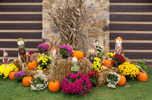 Autumn Festival Decorations With Pumpkins And Scarecrows