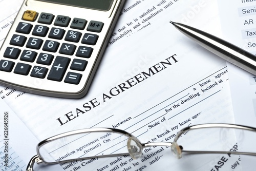 Fotografiet Lease Agreement Documents with Glasses, Pen and Calculator