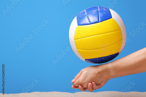 Hands of a beach volleyball female player digging a ball