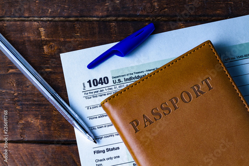 Filling In The Us Tax Form Tax Form 1040 Taxpayer Passport And A