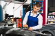 Mechanic grinding car bumper