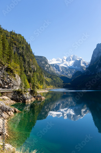 Poster Bergen Mountain landscape with reflection in the lake. Austrian Alps