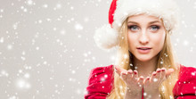 Young And Beautiful Girl In A Christmas Hat. Winter Concept.