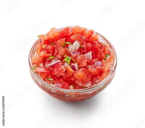 Fotografía  Tomato salsa dip top view isolated on white background
