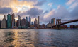 Brooklyn Bridge in New York City at clounds sky, Skyline of downtown New York, USA