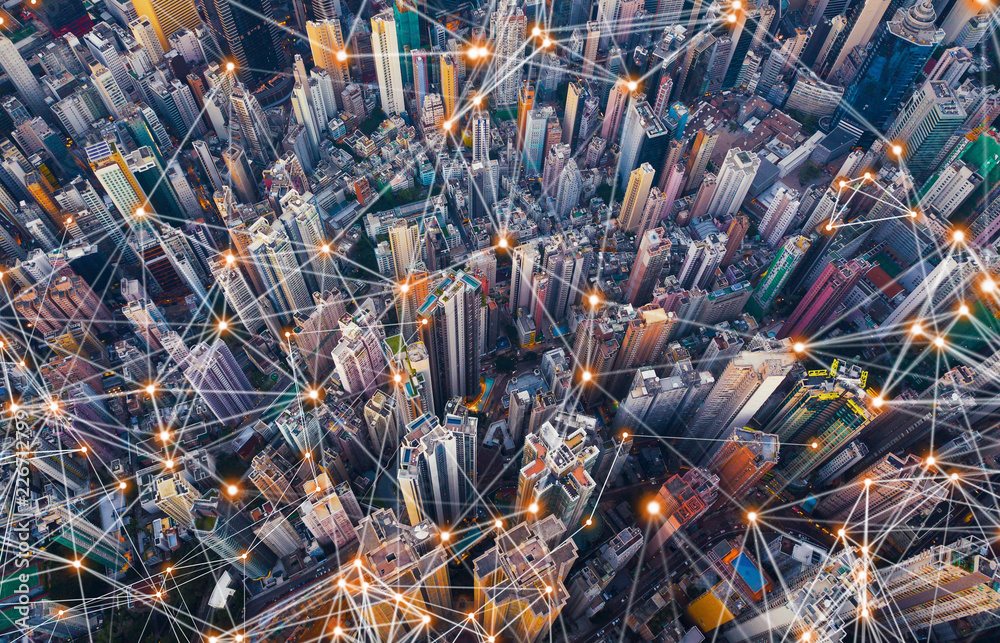 Fototapeta Digital network connection lines of Hong Kong Downtown. Financial district and business centers in smart city in technology concept. Top view of skyscraper and high-rise buildings. Aerial view