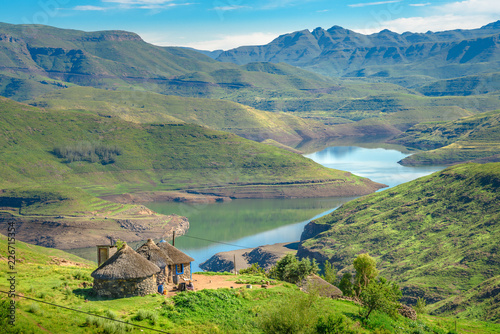 Foto auf AluDibond Pistazie Lesotho traditional hut house homes in Lesotho village in Africa. Beautiful scenic landscape of village in daytime with typical huts built by villagers by the lake of Mohale Dam