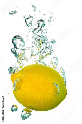 Lemon water splash with air bubbles Canvas Print