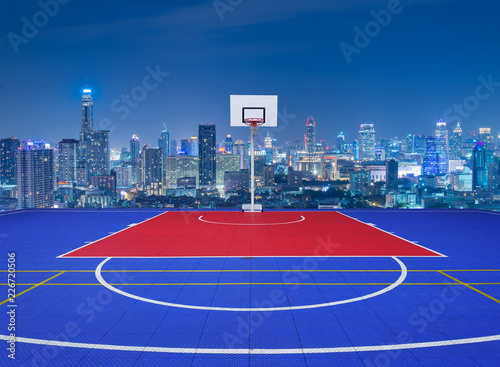 Basketball court with city skyline view. Canvas Print