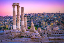 Amman, Jordan Its Roman Ruins In The Middle Of The Ancient Citadel Park In The Center Of The City. Sunset On Skyline Of Amman And Old Town Of The City With Nice View Over Historic Capital Of Jordan.