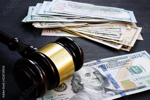 Photo  Bail bond and financial penalty. Gavel and money.