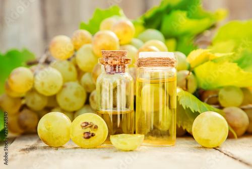 Fototapeta grape seed oil in a small jar. Selective focus. obraz