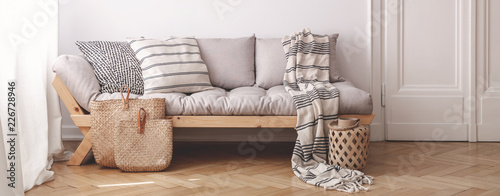 Panorama of pillows and blanket on wooden beige couch in white flat interior with door Tableau sur Toile