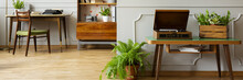 Panorama Of Record Player On Wooden Table In Natural Home Office Interior With Plants. Real Photo