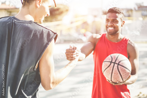 Happy athletes friends playing basketball outdoor in city urban contest - Young Wallpaper Mural