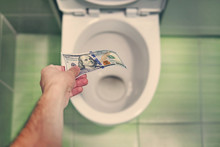 Concept Of Senseless Waste Of Money, Loss, Useless Waste, Large Water Costs, In The Toilet Wash A Thousand Dollars Bill