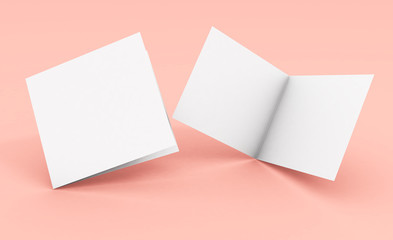 blank square bifold brochure on pink background