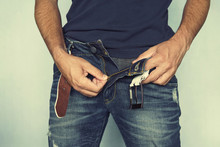 Man Unbuttoned Jeans, A Man's Hand Fastens A Fly On Jeans.