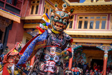 Buddhist Monk With Dragon Mask...