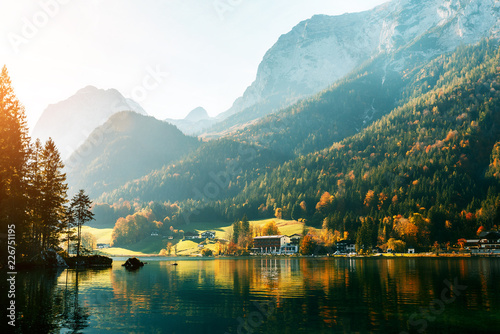 Alps, lake Hintersee in the morning, Majestic German Alps mountains under sunlight on a sunny day. Scenic view of the silent lake Hintersee in Ramsau, Germany. Popular location for photographers.
