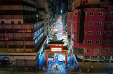 Temple Street Night Market Entrance In Hong Kong With Many Shops And Visitors