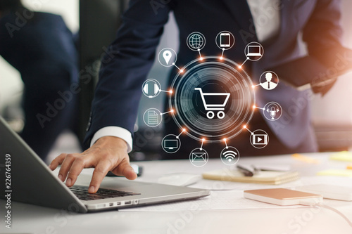 Digital marketing. Businessman working with laptop computer, tablet and smart phone. Modern interface payments online shopping and icon customer network connection.