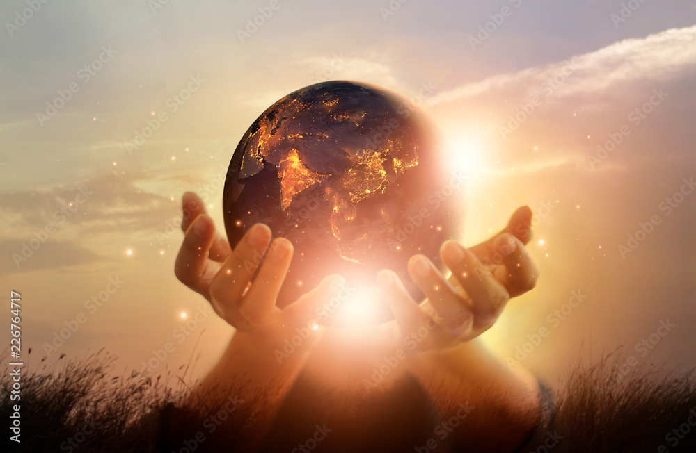 Fototapety, obrazy: Earth at night was holding in human hands. Earth day. Energy saving concept, Elements of this image furnished by NASA