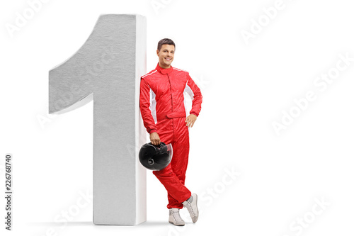 Racer leaning against number one