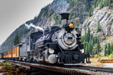 Vintage Steam Train Crossing a River in Colorado