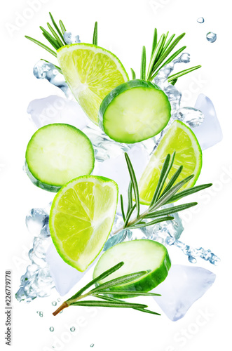 Lime, cucumber and rosemary flying with ices and water splash isolated