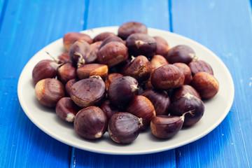 chestnuts on white dish