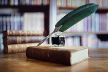 Quill Pen On An Old Book In A ...