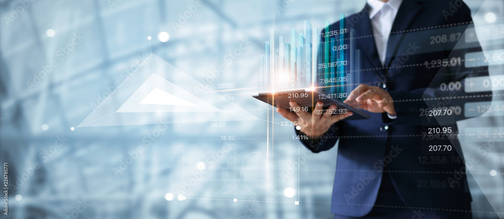 Fototapeta Businessman using tablet analyzing sales data and economic growth graph chart.  Business strategy. Abstract icon. Digital marketing